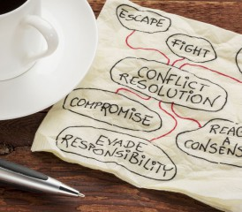 Napkin with ideas to resolve conflict.