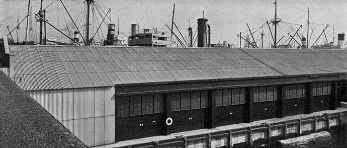 Dock warehouse with corrugated transite asbestos concrete panels