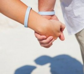 Holding hands with awareness wristbands