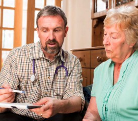 Doctor consults patient at home