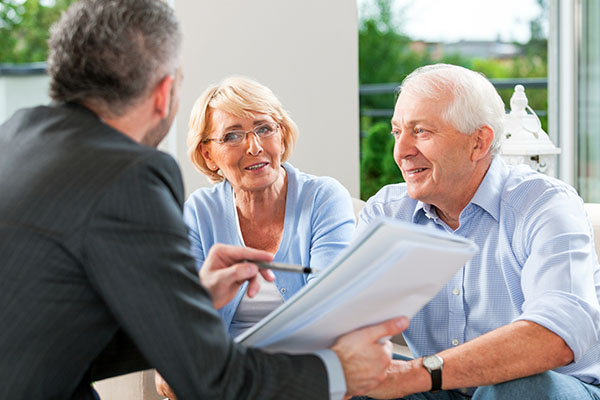 Mesothelioma lawyers speaking with an older family.