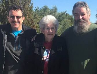 Mesothelioma survivor Emily Ward with her brothers
