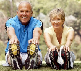 Older Couple Stretching After Workout Session