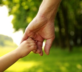 Man holding daughter's hand.