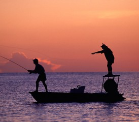 Two Friends Fishing at Sunset