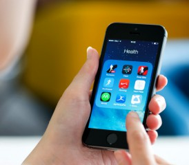 Woman uses apps on an iPhone