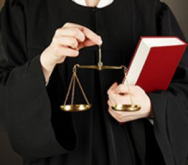 Judge holding scales in hands