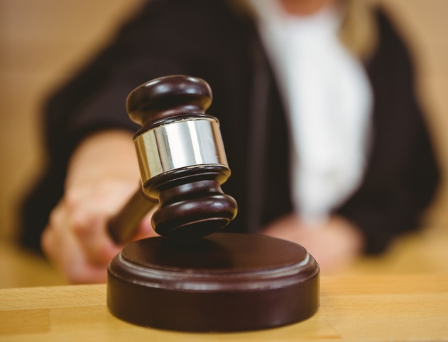 Judge with hand on gavel