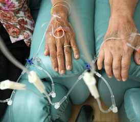 Patient's hands with IV tubes