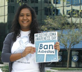 Nadia Persaud Holds Mesothelioma Awareness Day sign