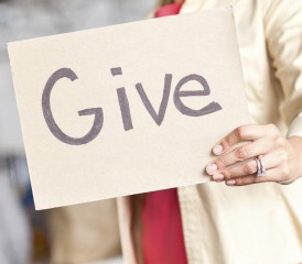 Woman holding sign for giving donations
