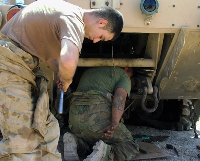 Military personnel working on repairs
