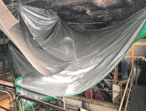 Tarp to catch asbestos debris at 207th St. Train Yard