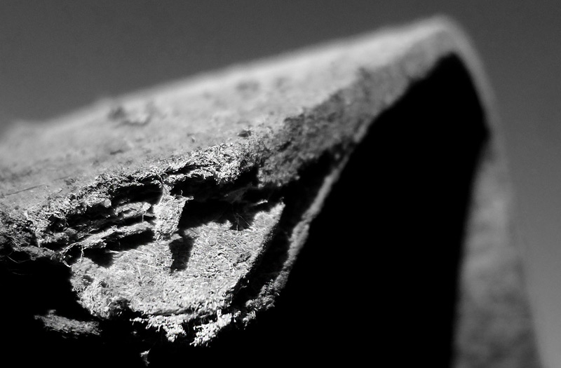 Broken slab of concrete containing nonfriable asbestos