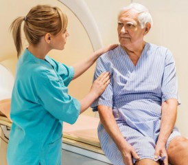 Oncologist speaks with her patient at MRI scanner