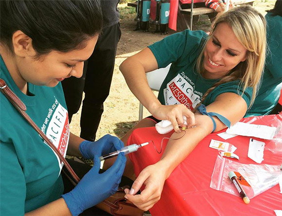 Woman donates blood at a Pacific Heart, Lung & Blood Institute walk