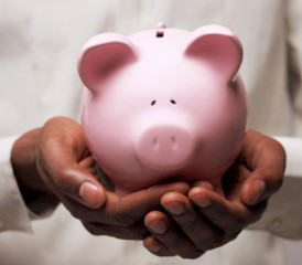 Hands Holding a Piggy Bank