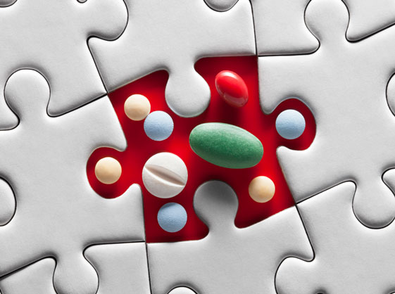Puzzle piece with pills