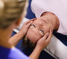 Patient undergoing Reiki treatment