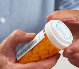 Man holding pill bottle