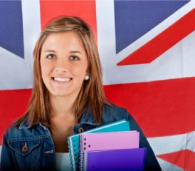 Student with British Union Jack flag in background