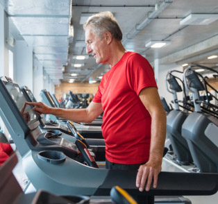 Senior on a treadmill at the gym