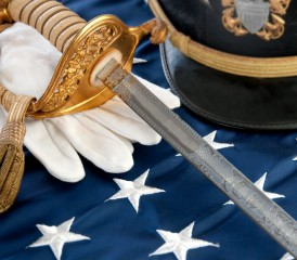 Military Sword, Hat & Glove on Flag