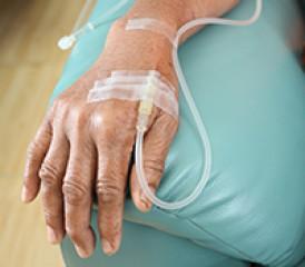 Hand with IV on armrest