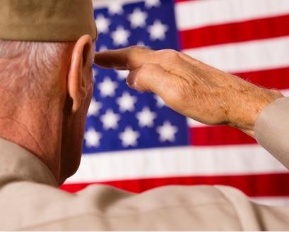 Military veteran saluting the American flag