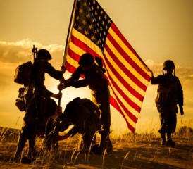 A group of soldiers hoisting the American flag