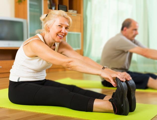 Older couple exercising at home