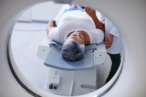 An older woman undergoing a CT-PET scan, a common tool in mesothelioma testing.