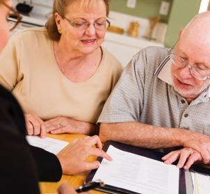 Older couple meeting with an attorney