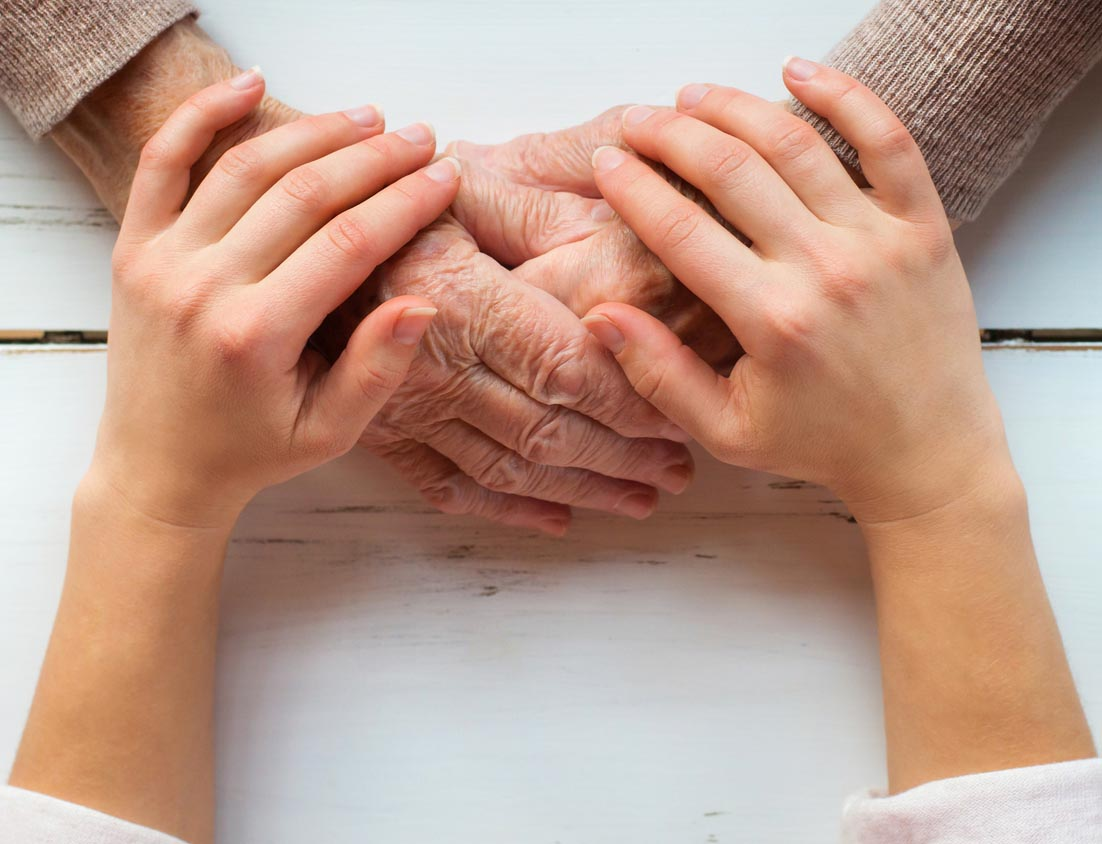 Young hands holding older hands